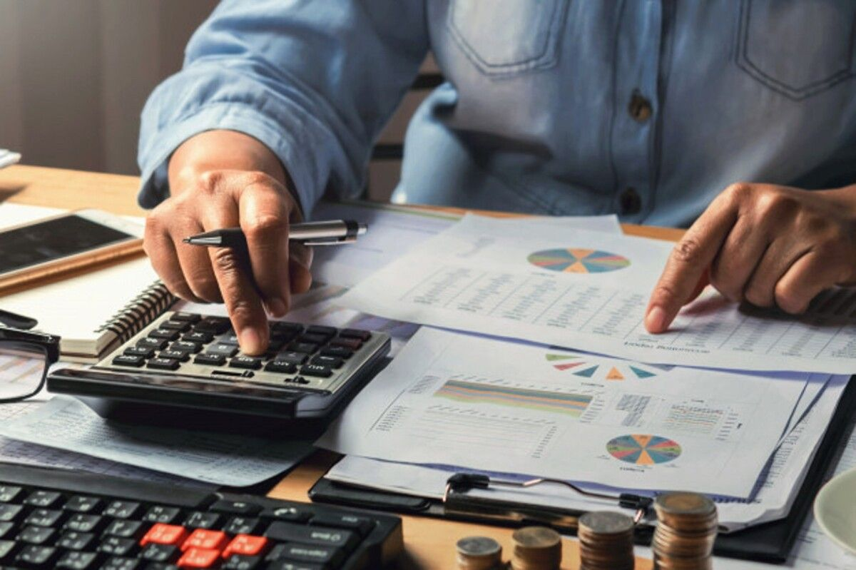 accounting concept businesswoman working using calculator with money stack office 34152 2245