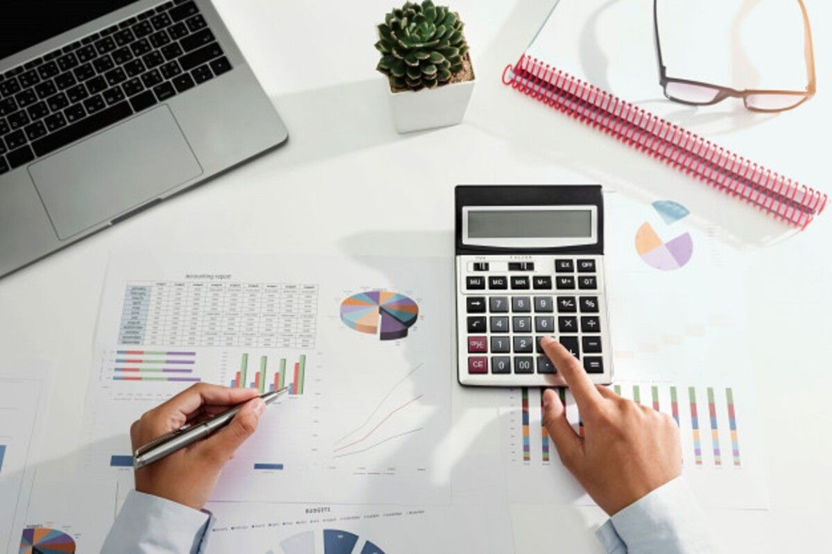businesswoman working desk using calculator laptop analyzing finance accounting office 34152 2162