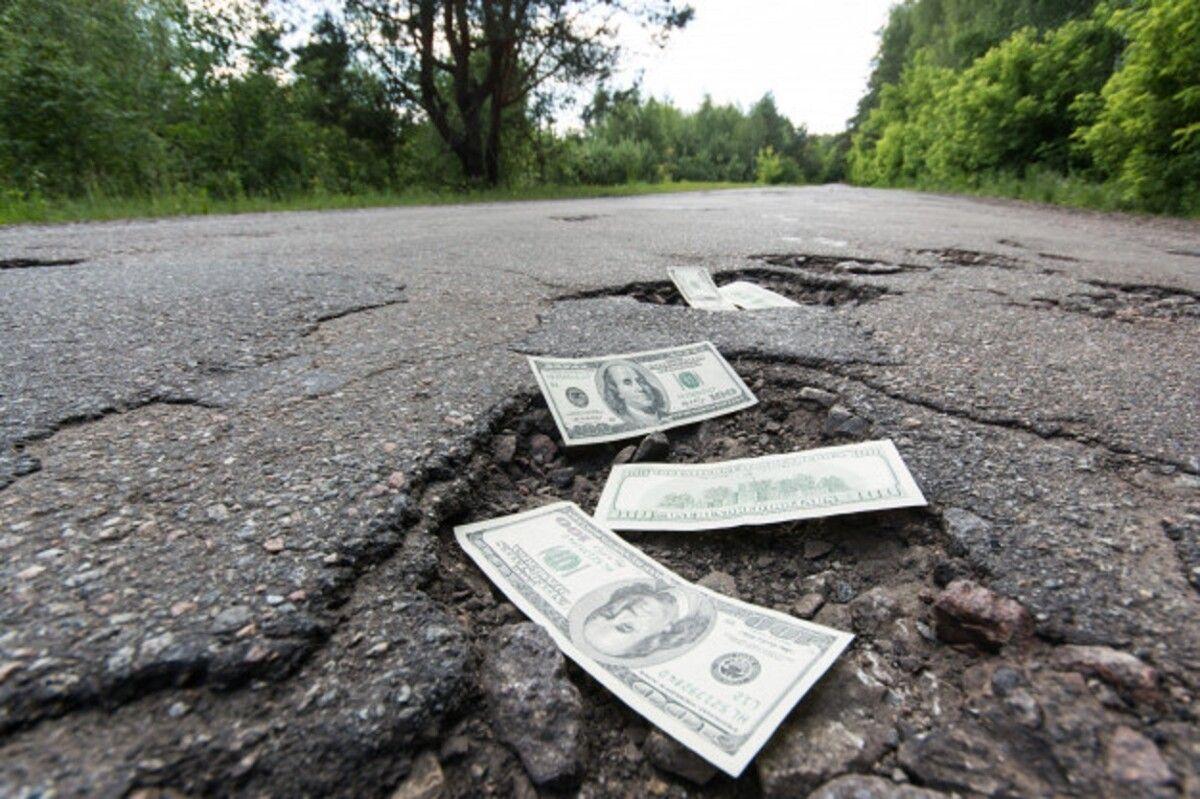 dollar bills potholes road 123211 58